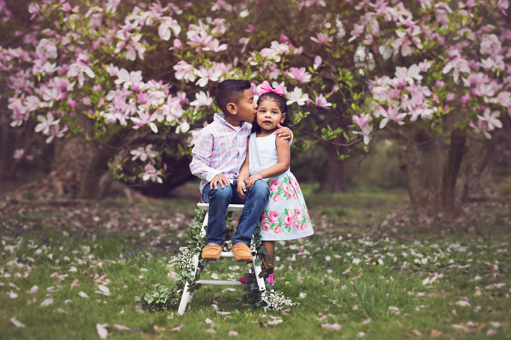 Siblings in outdoor session with magnolia tree