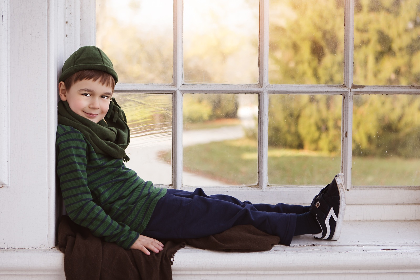 Child posing on the Mansion's Window