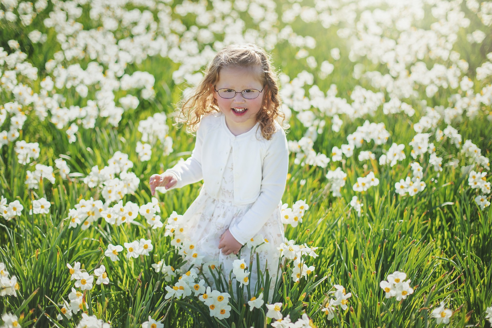 Girl Walking Through Daffodils in Cylburn Arboretum