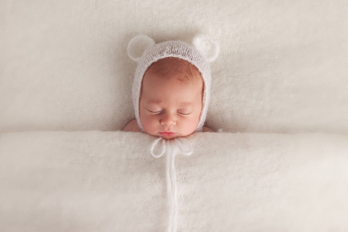 Newborn baby sleeping at photo shoot in Baltimore, Maryland