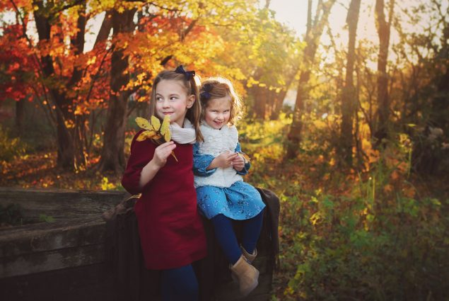 Sisters posing for autumn photoshoot