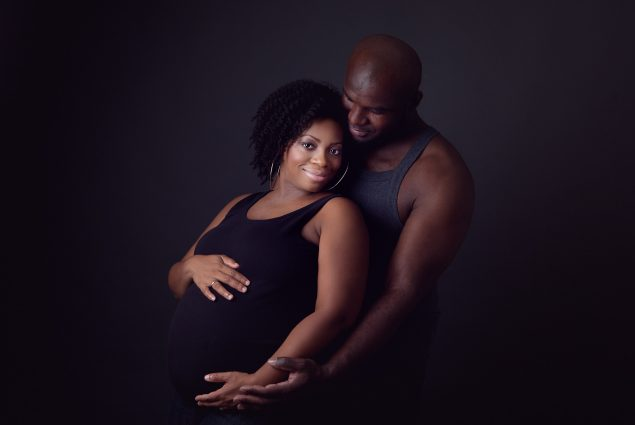 A couple in maternity session in studio