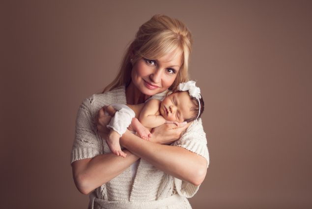 Baby and mommy posing in studio