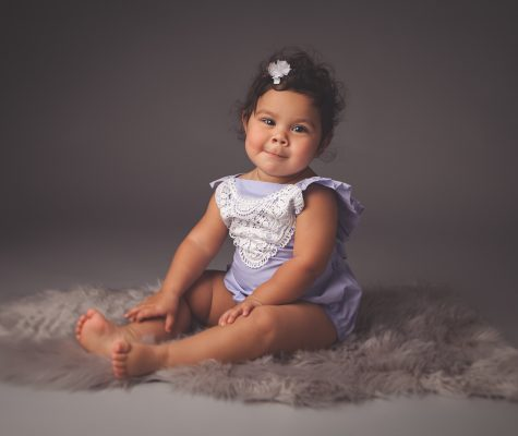 Cute baby girl posing for a milestone photo