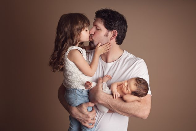 Dad and daughters professional studio portrait
