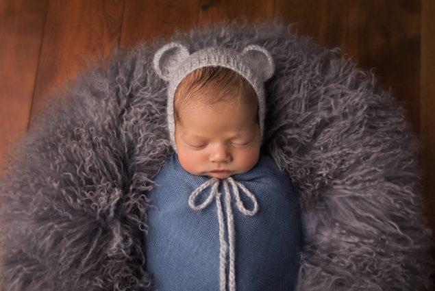 Newborn posing in Maryland studio