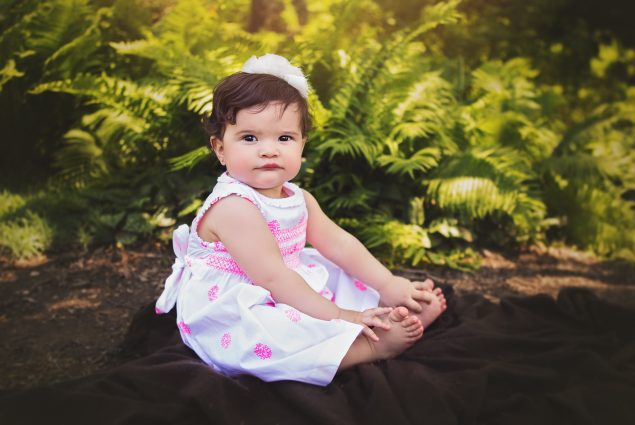 One year old girl in outdoor milestone session