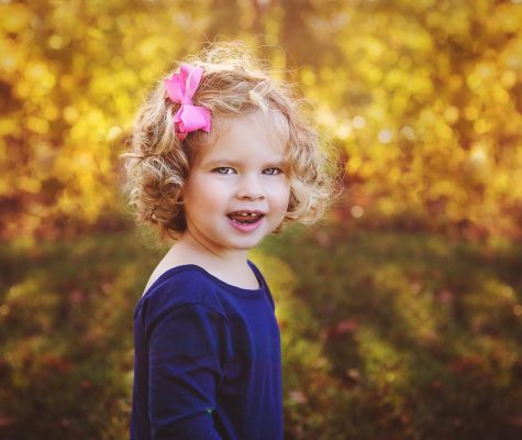 Outdoor fall portrait photoshoot of a child