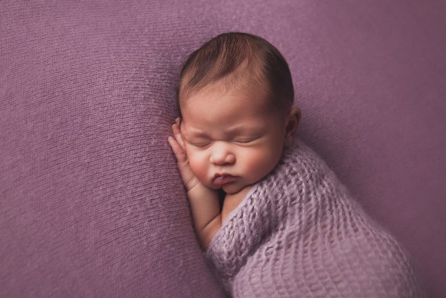Photo of a baby girl on purple