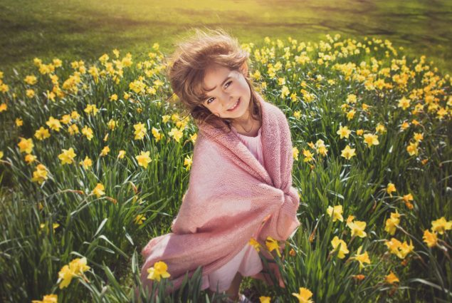 Picture of a girl in pink in daffodil field