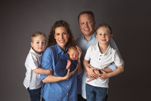 Professional studio portrait of family of five