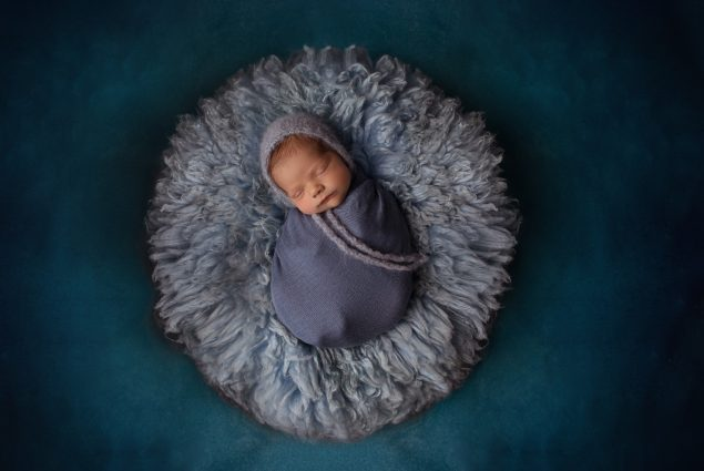 Professional studio setup in blue for newborn session