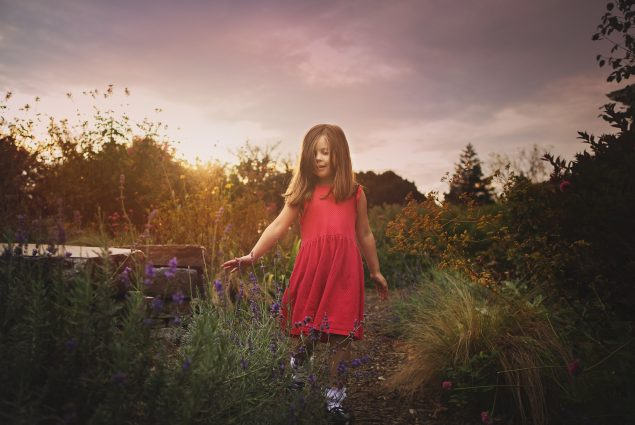 Sunset photo of a girl in red dress during nature photography session